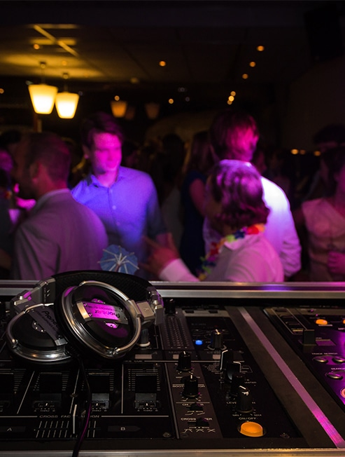 DJ decks and people on dance floor at Sydney New Years Eve Cruise